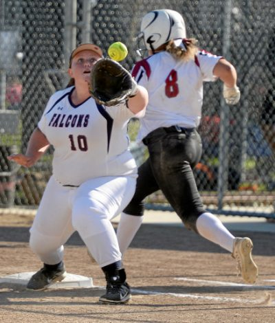 Vacaville Christian High School's first baseman, Maggie Mackenzie reaches for the relay throw as Buckingham's Payton Williams stretches for the bag during the seventh inning of the Falcons' 12-4 rout of the Knights during the first round of the section playoffs. Joel Rosenbaum -- The Reporter
